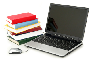 Bigstock-Laptop-And-Stack-Of-Books-930157